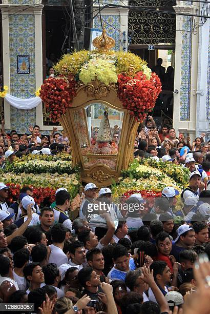 Pilgrims pay promises walking behind the image of Our Lady of Nazareth during the 'Cirio de Nazare' celebrations in Belem northern Brazil on October...