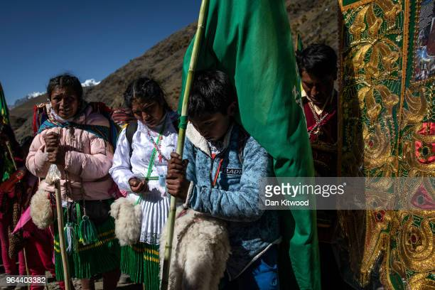 Pilgrims pray at a marker along the route to the annual Qoyllur Rit'i festival on May 27, 2018 in Ocongate, Peru. Every year, since 1783 in the...