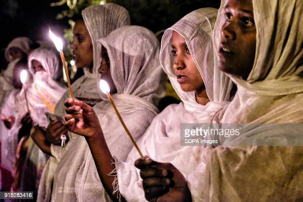 Pilgrims pray by candlelight The annual Timkat festival an Orthodox Christian celebration of Epiphany remembers the baptism of Jesus in the Jordan...