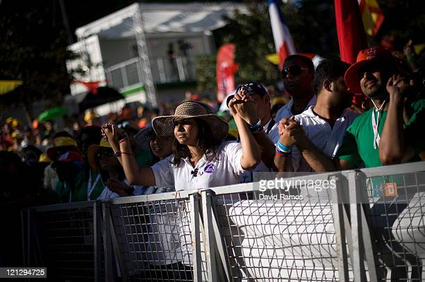 Pilgrims pray during a live concert as part of the World Youth Day 2011 on August 17 2011 in Madrid Spain Initiated by Pope John Paul II in 1985...