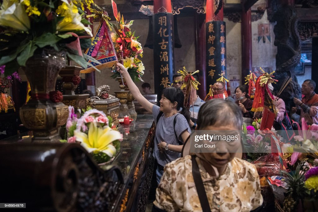 Pilgrims pray in Xingang Fengtian Temple where the statue of Mazu will rest for two nights before resuming its journey, on day four of the nine day Mazu pilgrimage on April 16, 2018 in Xingang, Taiwan. The annual Mazu Pilgrimage begins at Jenn LannTemple in Taichung and sees around 200,000 pilgrims walk up to 12 hours each day for nine days carrying a statue of Chinese sea goddess Mazu in a sedan chair. The journey covers around 350 kilometres and visits more than 100 temples before returning to Taichung. The centuries-old pilgrimage is now recognised by UNESCO as living heritage and with an estimated 5 million participants spread over the nine days, it is considered to be one of the greatest religious festivals in the world.