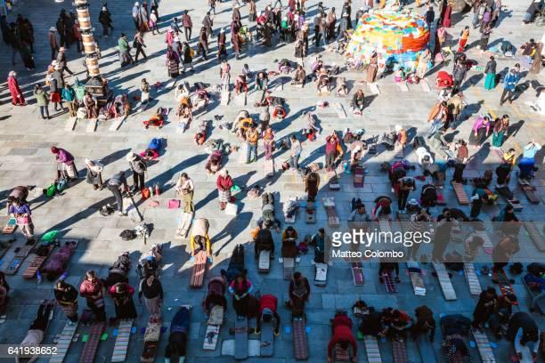 Pilgrims praying in Barkhor square, Lhasa, Tibet