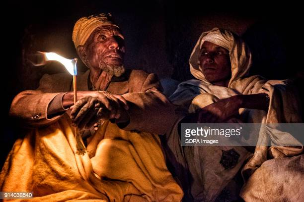 Pilgrims praying with candles lit at night outside the Biete Medhane Alem During the first days of January thousands of Ethiopian Orthodox Christian...