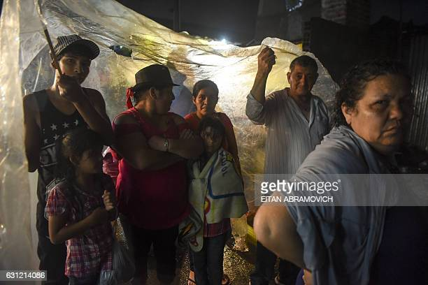 Pilgrims queue to visit Gauchito Gil's sanctuary near Mercedes in the Argentine province of Corrientes on January 8 2017 The cult of Gauchito Gil a...