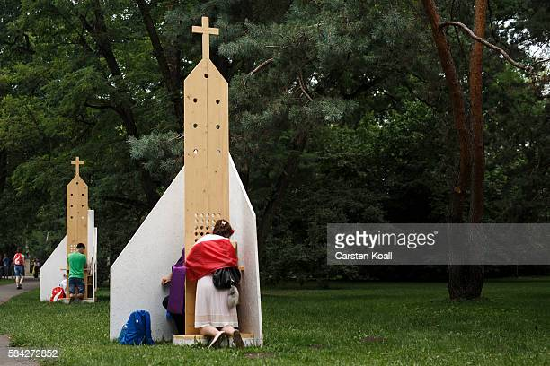 Pilgrims receive the sacrament of confession in Jordan Park on July 28 2016 in Krakow Poland Almost two million young people are expected to attend...