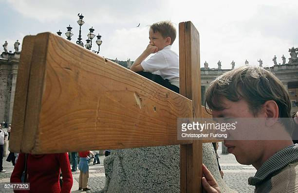 Pilgrims reenact the stations of the cross on Good Friday March 25 2005 in St Peter's Square Vatican City As Catholic pilgrims flocked to Rome Pope...