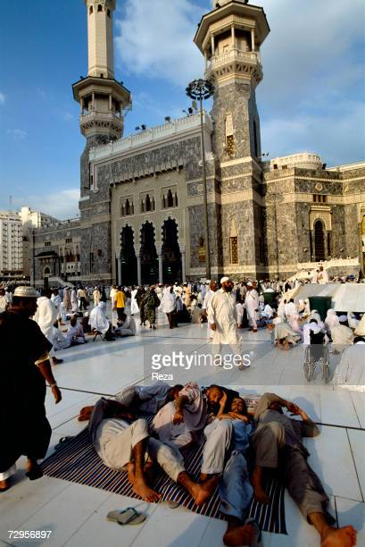 Pilgrims rest in front of the Masjid AlHaram mosque February 2003 in Mecca Saudi Arabia Over five days of Hajj pilgrims walk for miles resting and...