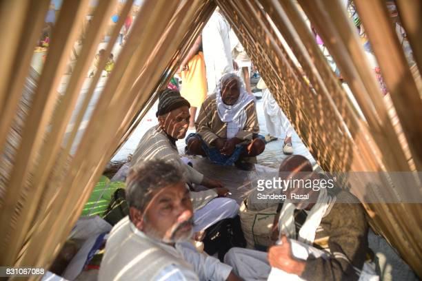 pilgrims resting at makeshift tent during ganga sagar fair - ganga sagar stock photos and pictures