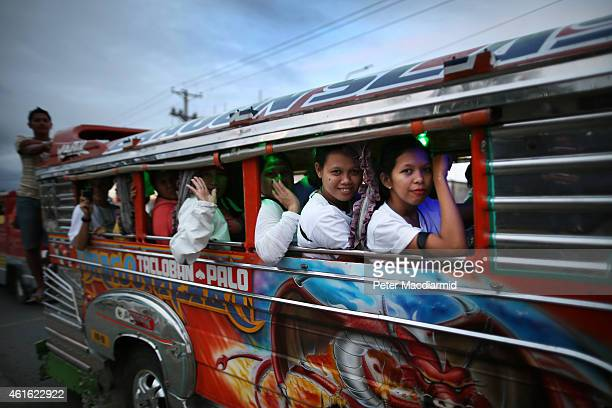 TACLOBAN LEYTE PHILIPPINES JANUARY 16 Pilgrims ride a traditional Jeepney taxi bus to the site of Saturday's mass on January 16 2015 in Tacloban...