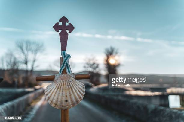 pilgrim's shell and classic stick detail view on the way to santiago de compostela - pilgrimage stock pictures, royalty-free photos & images