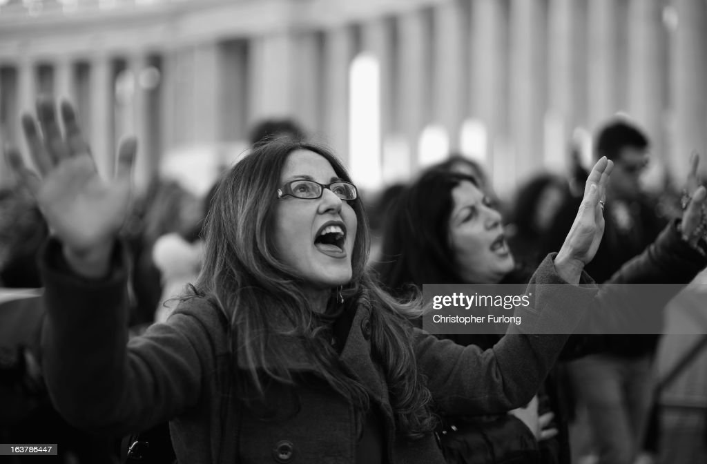 Pilgrims sing songs in St Peter's Square during a prayer meeting to honour Pope Francis on March 15, 2013 in Vatican City, Vatican. Daily life continues around the vatican as romans prepare for the inauguration mass of Pope Francis, the first ever Latin American Pontiff.