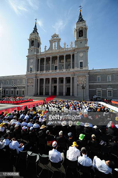 Pilgrims sitted outside at the Almudena Cathedral attend a mass celebrated by Pope Benedict XVIduring the World Youth Day festivities in Madrid on...