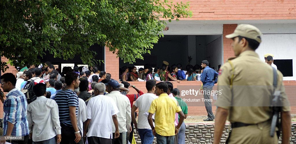 Pilgrims standing in a queue for the registration for the annual pilgrimage to the Amarnath cave shrine at registration centre on July 5, 2013 in Jammu, India. Jammu and Kashmir Government said it will not allow any unregistered pilgrim to Amarnath cave shrine. Thousands of pilgrims annually visit the remote Himalayan shrine of Amarnath at 3,888 meters (12,756 feet) above sea level to worship an icy stalagmite representing Shiva, the Hindu god of destruction.