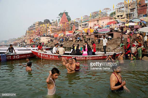 Pilgrims take a a holy bath in the waters of the river Ganges in Varanasi Varanasi is a holy town for the Hindus where numerous religious events take...