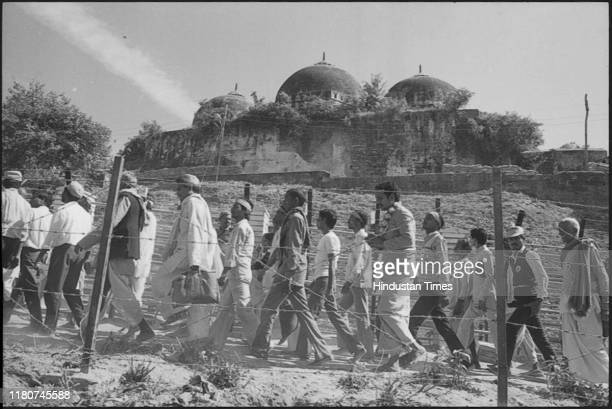 Pilgrims take a Parikarma of displayed Babri Masjid and Ram Janm bhoomi through Barbed Fencing at Ayodhya