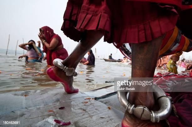 CONTENT] Pilgrims take bath at the bank of Sangam confluence of river Ganga Yamnuna and mythical Saraswati at Kumbh mela in Allahabad Uttar...