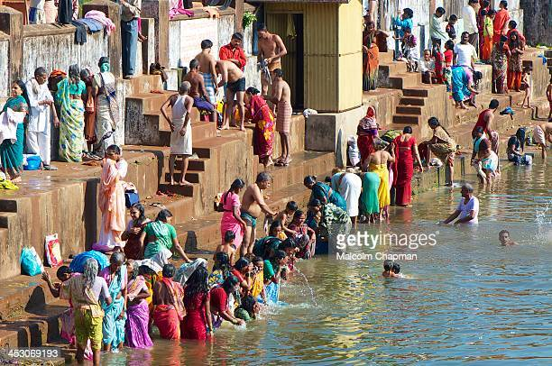 CONTENT] Pilgrims taking a ritual dip during Shivaratri festival Gokana Karnataka India on February 20 2012 in the Kotitheertha tank a man made...