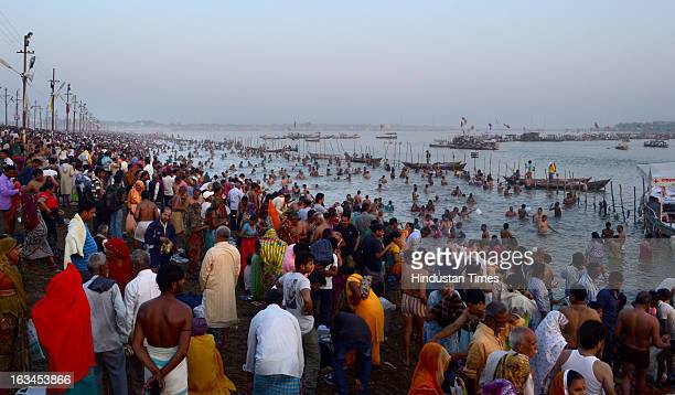 Pilgrims taking holy dip in Sangam waters on Mahashivratri Snan, in a Kumbh Mela area, on March 10, 2013 in Allahabad, India. The snan marked...