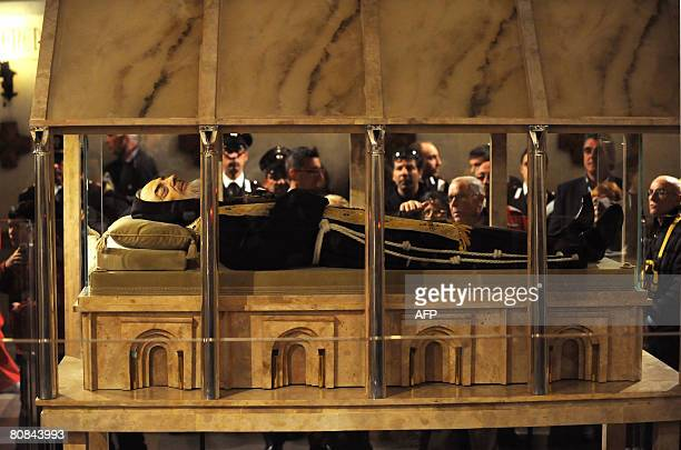 Pilgrims venerate the body of Padre Pio in a partglass coffin in the crypt of the old Church of St Mary of Grace at San Giovanni Rotondo in the...
