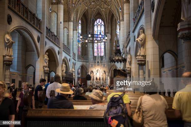 Pilgrims visit the All Saints' Church the site where the Ninetyfive Theses were likely posted by reformer Martin Luther on May 27 2017 in Wittenberg...