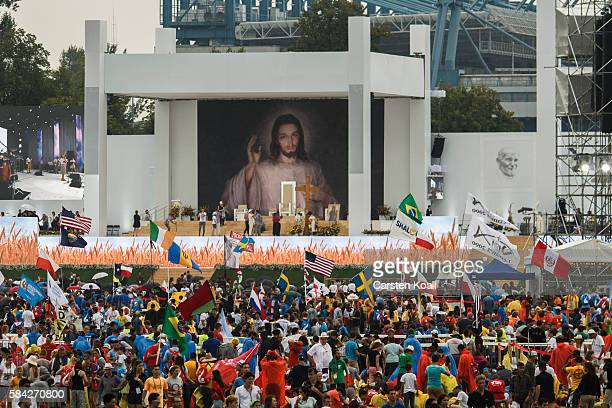 Pilgrims wait of front of the altar of the beginning of the welcome ceremony by Pope Francis at the World Youth Days at Blonia Park on July 28 2016...