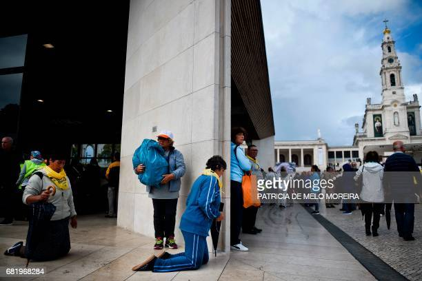 Pilgrims walk on their knees at the 'Capelinha das Aparicoes' chapel in Fatima central Portugal on May 11 2017 Two of the three child shepherds who...