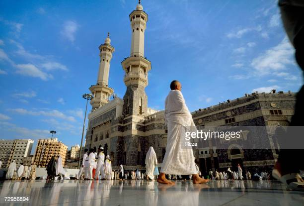 Pilgrims walk outside the Masjid AlHaram mosque location of the Kaaba Islam's most sacred sanctuary and pilgrimage shrine February 2003 in Mecca...