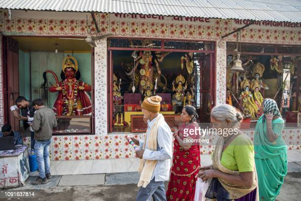 Pilgrims walk past Hindu shrines in Ayodhya Uttar Pradesh India on Friday Jan 18 2019 The holy city of Ayodhya is at the center of India's most...