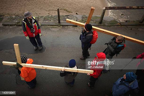 Pilgrims walk with crosses as the Northern Cross pilgrimage makes its final leg of the journey to Holy Island on April 6, 2012 in Berwick-upon-Tweed,...