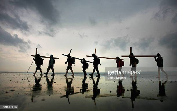 Pilgrims walk with crosses as the Northern Cross pilgrimage makes it's final leg of its journey to Holy Island on April 10 2009 in England More than...