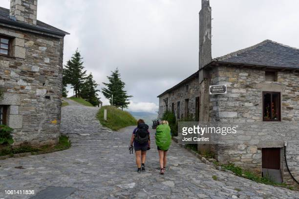 pilgrims walking through o cebreiro on camino de santiago - pilgrimage stock pictures, royalty-free photos & images