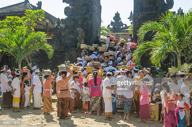 pilgrims walking to a temple ceremony in bali - indonesia - religious celebration stock pictures, royalty-free photos & images