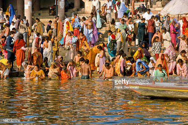Pilgrims washing away sins by doing ritual cleansing in the waters of the holy Ganges