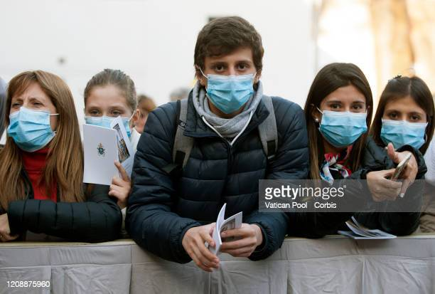 Pilgrims wearing protective face mask against Coronavirus attend the Ash Wednesday mass led by Pope Francis which opens Lent the fortyday period of...