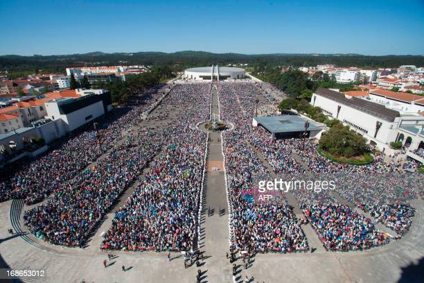 Pilgrins attend a mass cceremony at the Fatima catholic shrine in Fatima central Portugal on May 13 2013 Thousands of pilgrims converged on Fatima...