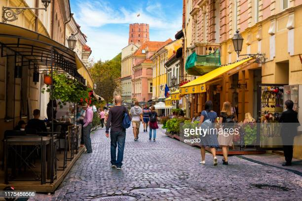 pilies street in vilnius old town - vilnius stock pictures, royalty-free photos & images