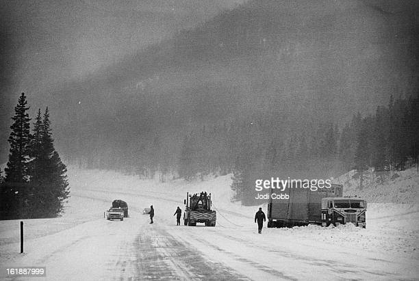 JAN 28 1975 JAN 29 1975 Piling Snow Delays Truck in Tuesday Storm in Rockies A large freightloaded truck gets a tow out of a pile of deep snow in the...