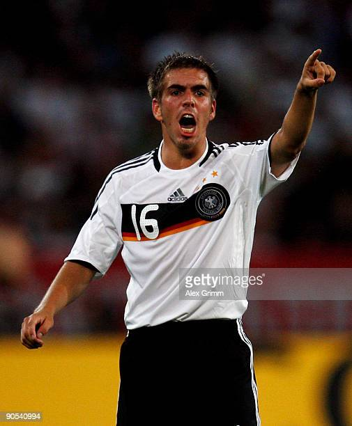 Pilipp Lahm of Germany points during the FIFA 2010 World Cup Group 4 Qualifier match between Germany and Azerbaijan at the AWD Arena on September 9...