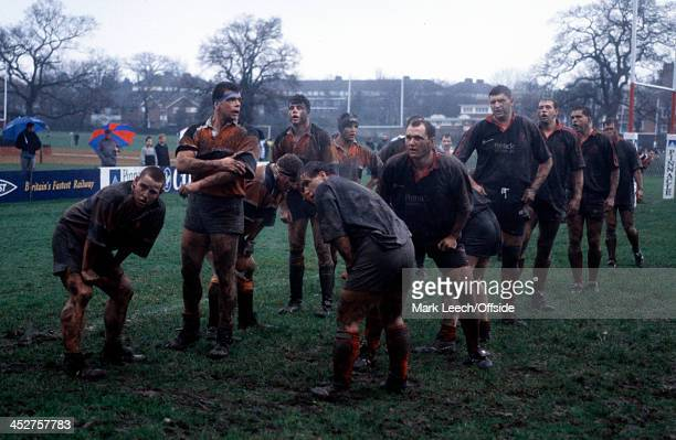 Pilkington Cup rugby - Saracens v Rugby, Players stand awaiting a lineout in the dark damp conditions at Bramley Road.