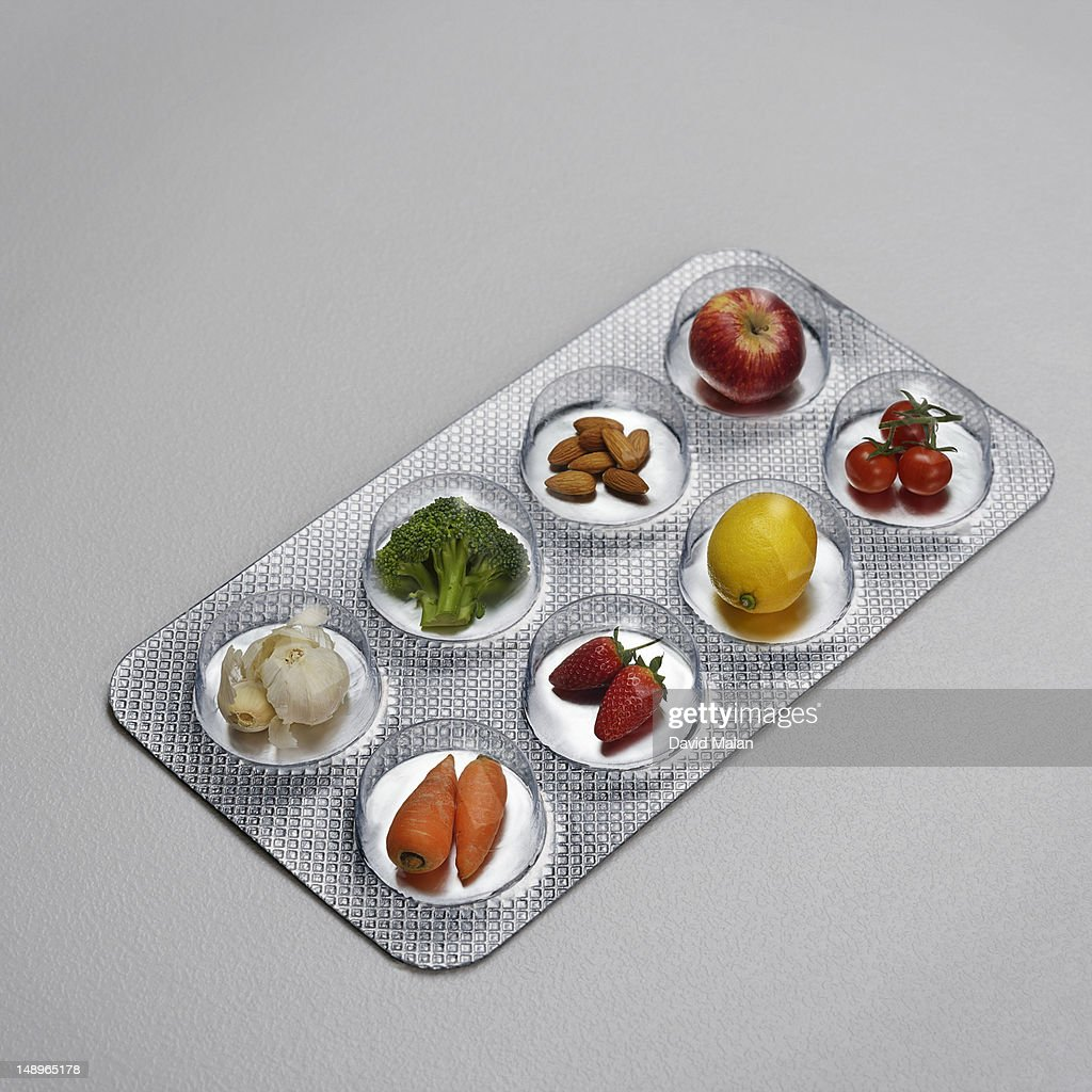 Pill blister pack containing fruit and vegtables : Stock Photo