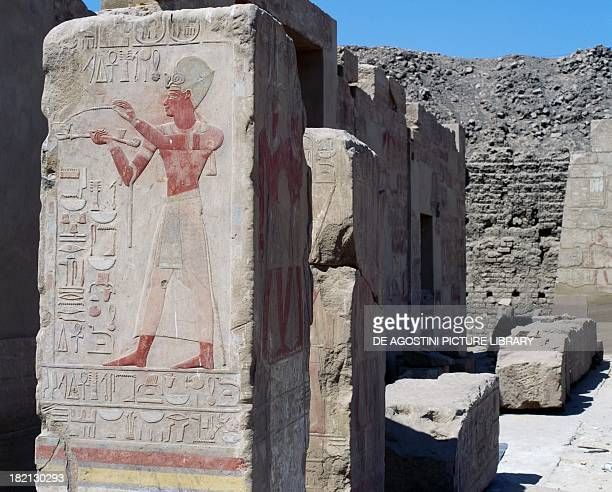 Pillar decorated with painted relief depicting the King offering incense Open air museum at Karnak Egyptian civilisation