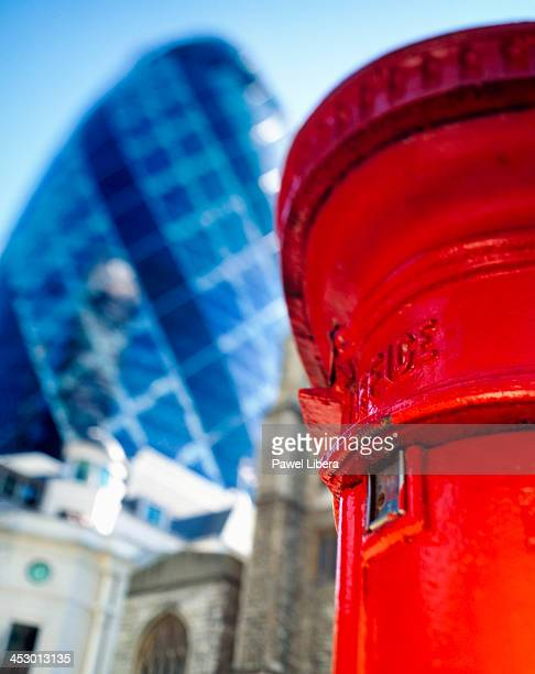 Pillar post box and Swiss Re Tower in the city of London