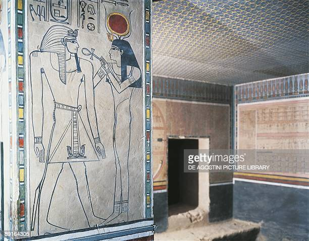 Pillar with a depiction of goddess Isis with ankh and dead pharaoh