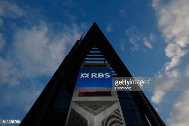 A pillar with a logo stands outside the Royal Bank of Scotland Group Plc headquarters in London UK on Wednesday Feb 15 2017 RBS is preparing to cut...