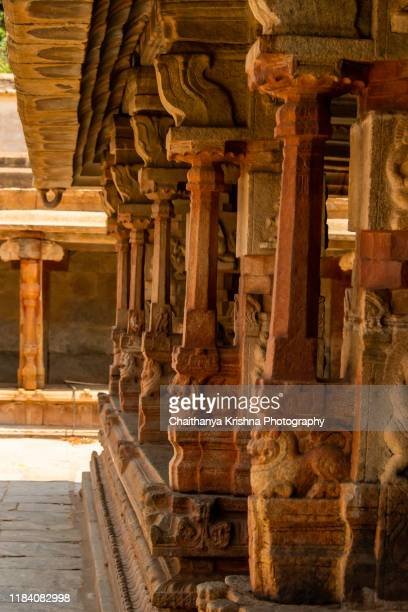 pillars around the main temple complex in yogi nandishwara temple on the way to nandi hills on the outskirts of bangalore - carving craft product stock pictures, royalty-free photos & images