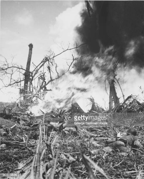 Pillbox Exterminators A Marine uses a flame thrower to burn the enemy out of a hidden pillbox on Guam July 1944 Although the Japs were surrounded by...