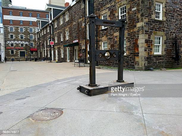 pillory on street against old buildings - pillory stock photos and pictures