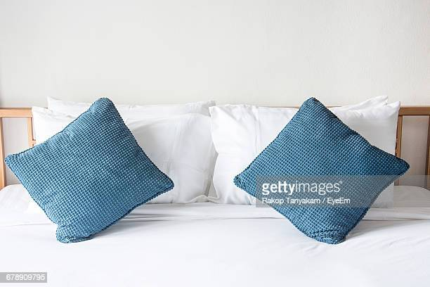 pillow and cushions arranged on bed at home - tidy room stock pictures, royalty-free photos & images