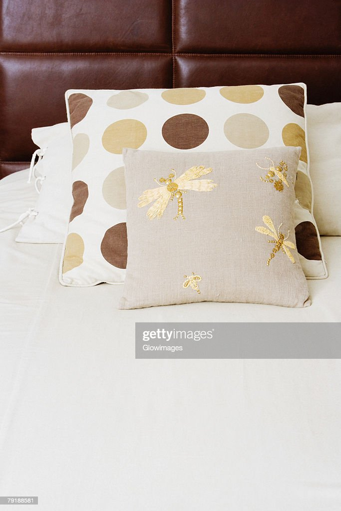 Pillow and cushions on the bed : Stock Photo