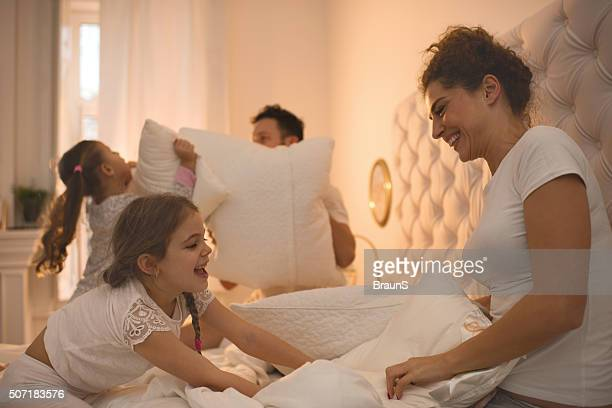 Pillow fight in a bedroom!